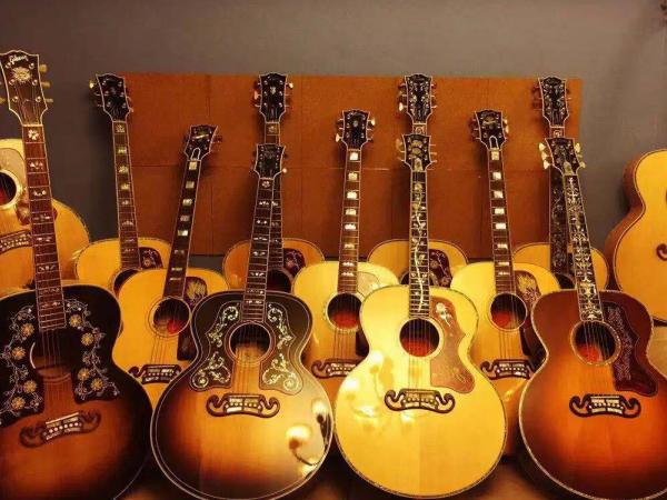 吉他_买电弹拨类乐器哪里便宜-河南欧乐乐器批发有限公司