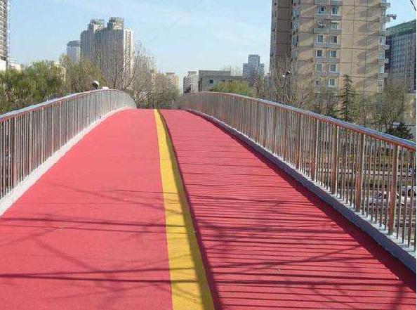 人行天橋彩色路面哪家便宜_高速公路工地施工材料供應商-湖北康曼材料科技有限公司
